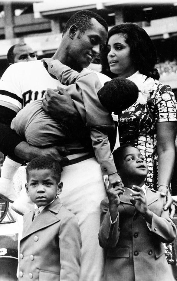 Roberto Clemente held his son Roberto Jr. during ceremonies honoring him in Pittsburgh. With the two are Clemente's wife, Vera, and their two older sons, Enrique (right) and Luis.
